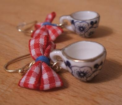 teeny tiny teacup earrings on table