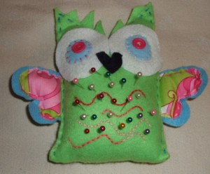Pincushion owl with pins