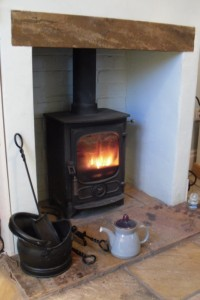 Log fire and teapot